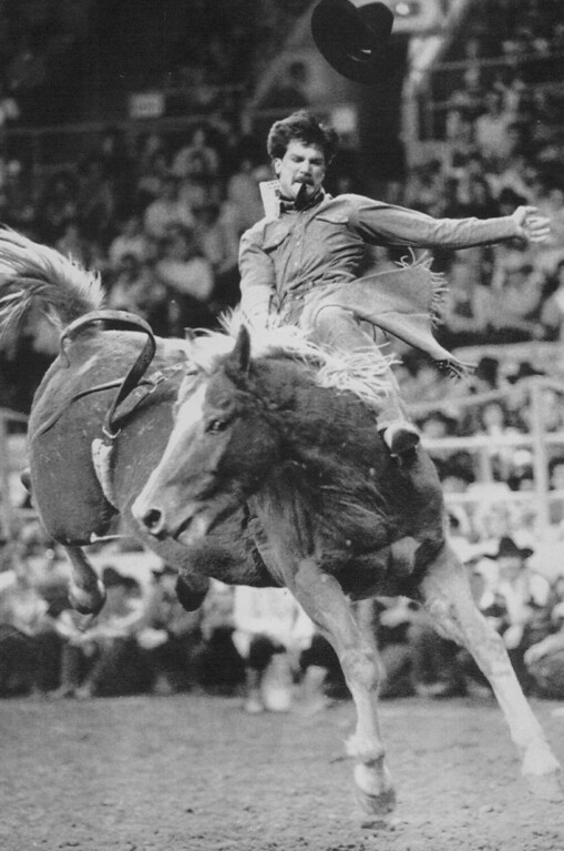 """. High-Flying Act -- Barry Copeland of Kersey, Colo., loses his hat as he tries to hold on to a horse named \""""Jambalaya\"""" during the bareback bronc riding competition at the National Western Stock Show and Rodeo Sunday afternoon at the Denver Coliseum. Rodeo riders from across the country and Canada are competing in the 83rd edition of the National Western through next Sunday. 1989 Credit: AP Laserphoto"""
