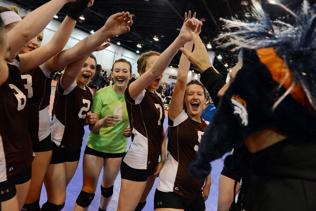. DENVER, CO. - MARCH 02: Members of the Colorado North Stars, of Loveland, celebrate their victory over Mountain West, of  Cache Valley, UT, during the  Colorado Crossroads National Qualifier volleyball tournament at the Colorado Convention Center in Denver, CO March 02, 2013. The event, held over two weekends,  is one of nine national tournaments that lead up to the USA Junior National Girls\' Volleyball Championships. Close to 700 teams will play on 89 courts through the weekend. (Photo By Craig F. Walker/The Denver Post)