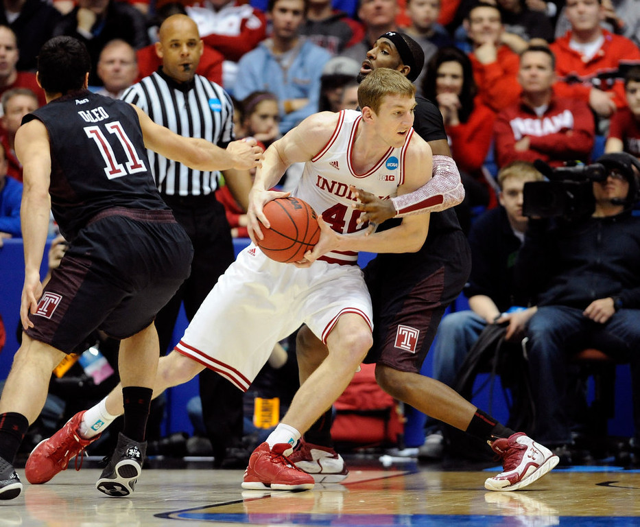 . Cody Zeller #40 of the Indiana Hoosiers drives with the ball against Anthony Lee #3 of the Temple Owls in the second half during the third round of the 2013 NCAA Men\'s Basketball Tournament at UD Arena on March 24, 2013 in Dayton, Ohio.  (Photo by Jason Miller/Getty Images)