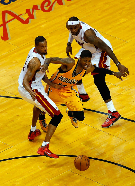 . MIAMI, FL - MAY 30: Paul George #24 of the Indiana Pacers drives to the basket against Rashard Lewis #9 and LeBron James #6 of the Miami Heat during Game Six of the Eastern Conference Finals of the 2014 NBA Playoffs at American Airlines Arena on May 30, 2014 in Miami, Florida.  (Photo by Chris Trotman/Getty Images)