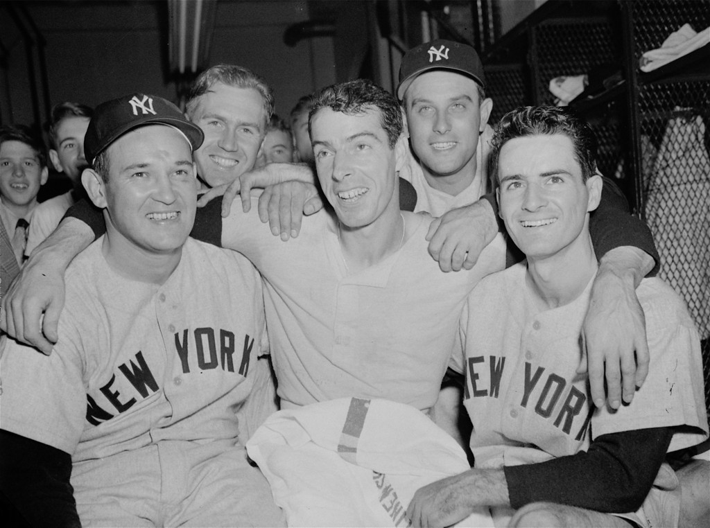 . This is an Oct. 5, 1950, file photo showing Joe DiMaggio, flanked by teammates after the Yankees beat the Philadelphia Phillies 2-1 in Game 2 of the World Series, in Philadelphia. DiMaggio homered in the 10th inning to win the game. Left to right:  Allie Reynolds, Bobby Brown; DiMaggio, Gene Woodling, and Gerry Coleman. Game 1 of the 2009 World Series is scheduled for Wednesday Oct. 28 in New York. (AP Photo/File)