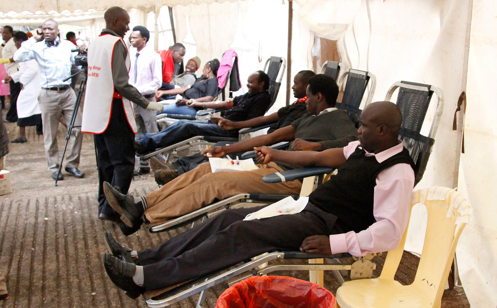 . People donate blood for injured persons in an attack at the Westgate Mall, at Uhuru Park in Nairobi, Kenya, Monday, Sept. 23, 2013.  (AP Photo/Khalil Senosi)