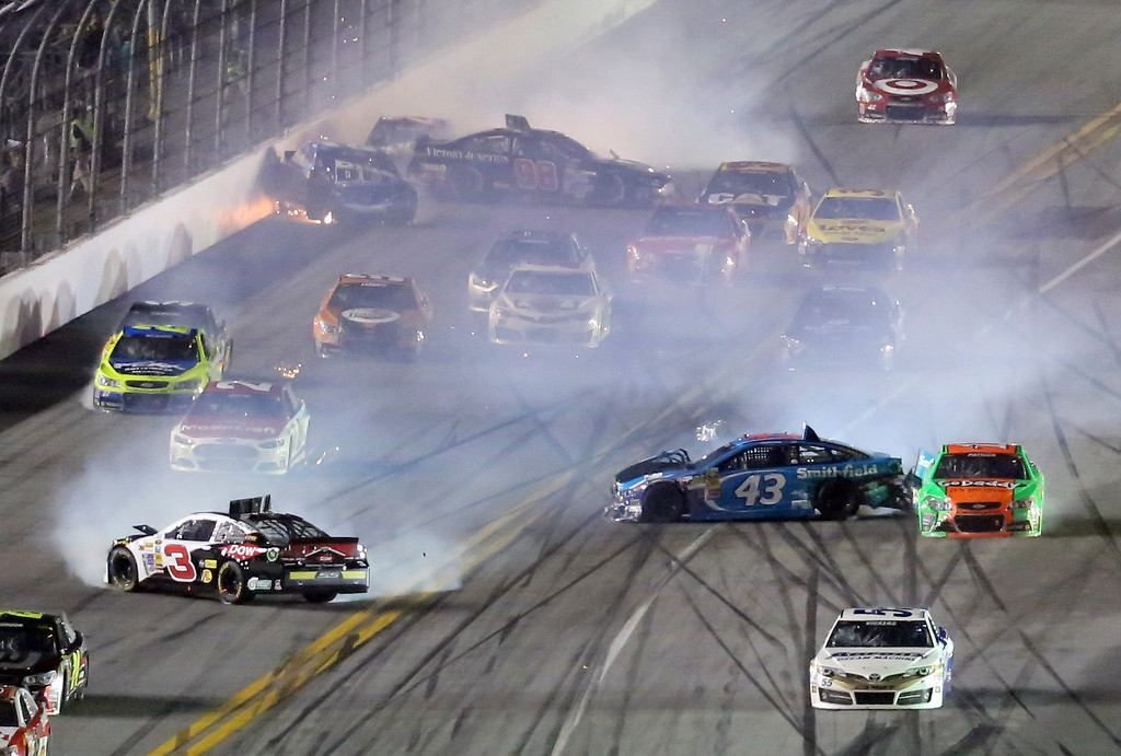 . Austin Dillon (3), Kyle Larson (42), Danica Patrick (10), and others crash during the NASCAR Daytona 500 Sprint Cup series auto race at Daytona International Speedway in Daytona Beach, Fla., Sunday, Feb. 23, 2014. (AP Photo/David Graham)