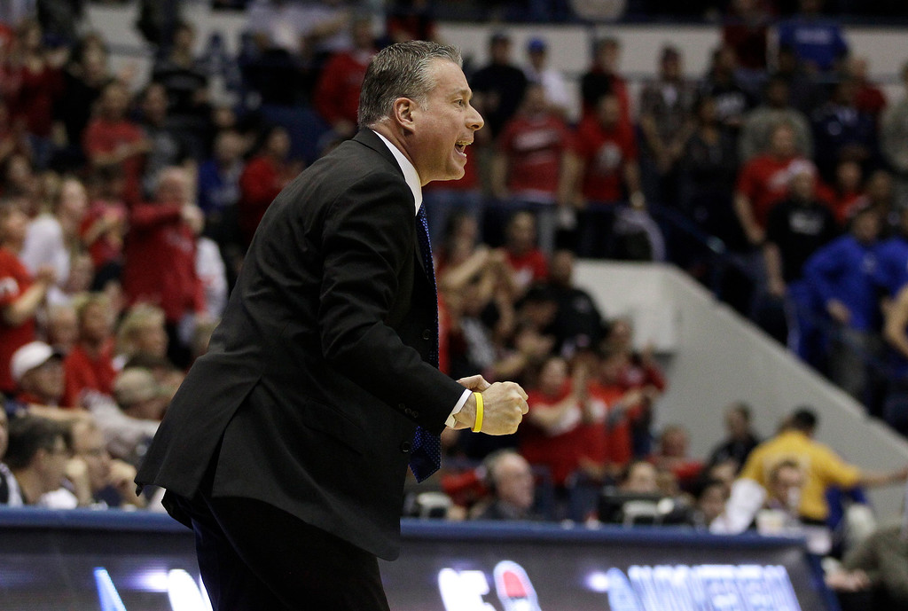 . Air Force head coach Dave Pilipovich reacts during the second half of an NCAA college basketball game against New Mexico in Air Force Academy, Colo., Saturday, March 9, 2013. Air Force defeated New Mexico 89-88. (AP Photo/Brennan Linsley)