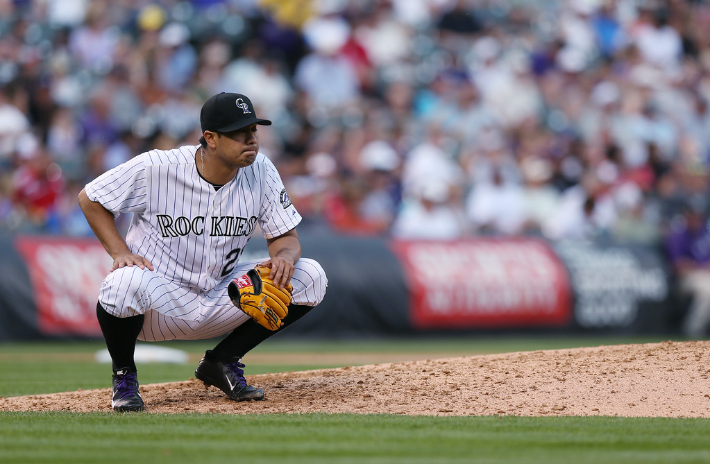 . Colorado Rockies starting pitcher Jorge De La Rosa reacts after giving up a single to Washington Nationals\' Adam LaRoche in the sixth inning of a baseball game in Denver on Wednesday, July 23, 2014. (AP Photo)