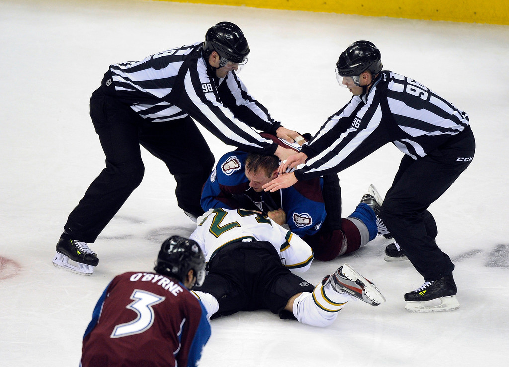 . DENVER, CO. - MARCH 12: Officials broke up a fights between Eric Nystrom (24) of the Dallas Stars and Jan Hejda (8) of the Colorado Avalanche in the second period. Both players were given five minutes in the box for fighting. The Colorado Avalanche hosted the Dallas Stars Wednesday night, March 19, 2013 at the Pepsi Center in Denver. (Photo By Karl Gehring/The Denver Post)