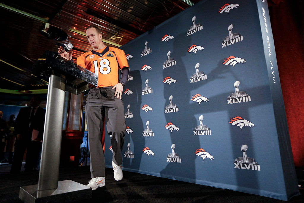 . Denver Broncos quarterback Peyton Manning walks to the podium for a news conference Thursday, Jan. 30, 2014, in Jersey City, N.J. The Broncos are scheduled to play the Seattle Seahawks in the NFL Super Bowl XLVIII football game Sunday, Feb. 2, in East Rutherford, N.J. (AP Photo/Mark Humphrey)