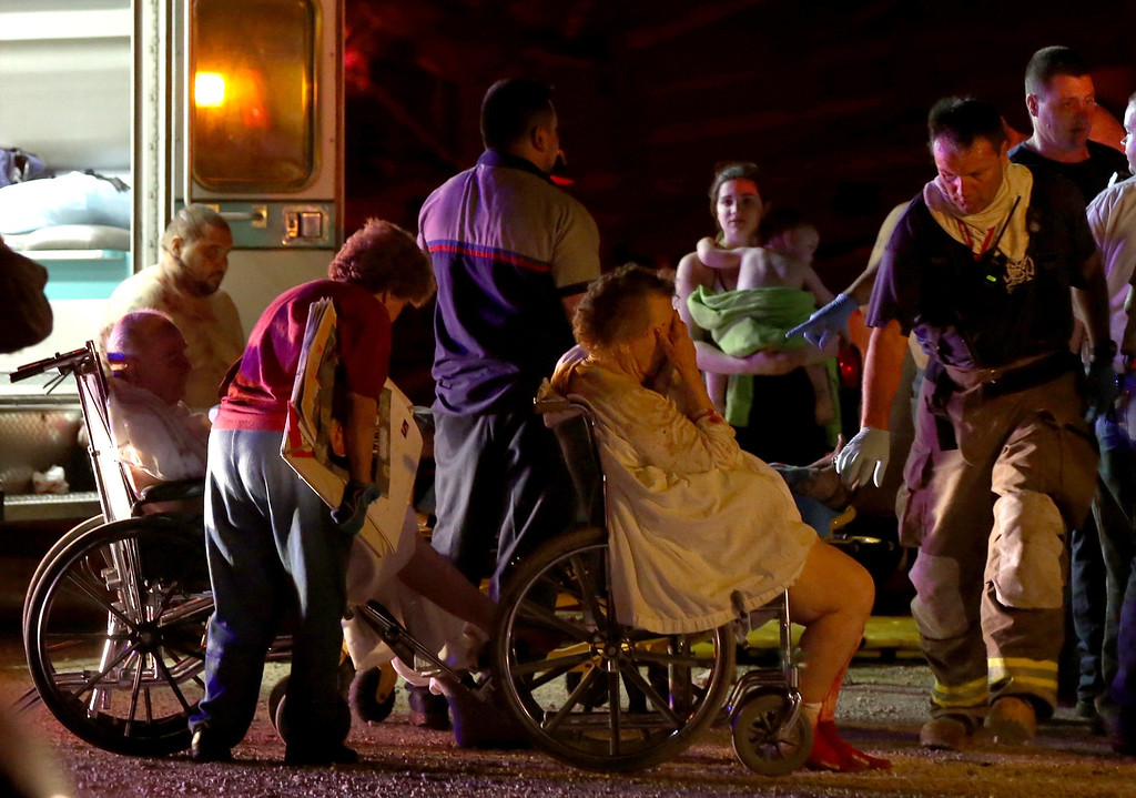 . Emergency workers evacuate elderly from a damaged nursing home following an explosion at a fertilizer plant Wednesday, April 17, 2013, in West, Texas. An explosion at a fertilizer plant near Waco caused numerous injuries and sent flames shooting high into the night sky on Wednesday. (AP Photo/ Waco Tribune Herald, Rod Aydelotte)