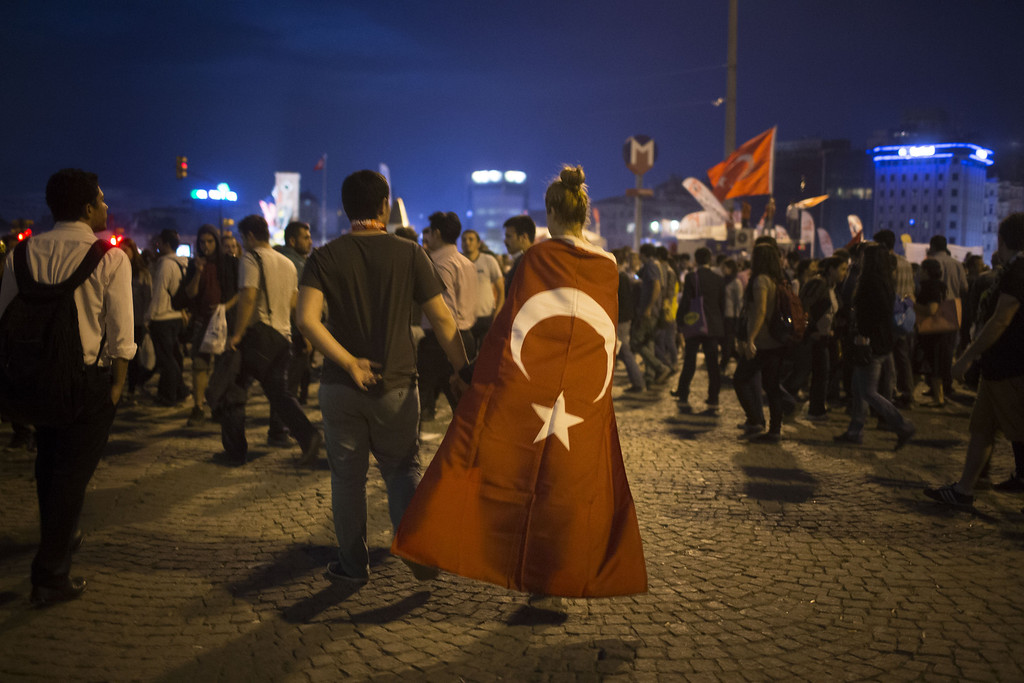 . Protestors walk in Taksim Square on June 4, 2013 in Istanbul, Turkey. The protests began initially over the fate of Taksim Gezi Park, one of the last significant green spaces in the center of the city.  (Photo by Uriel Sinai/Getty Images)