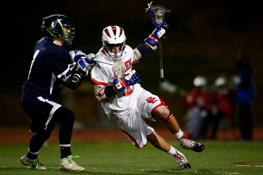 . Cherry Creek\'s Hunter Thompson works against Columbine\'s Ian Lewis during Cherry Creek\'s 7-6 win.  (Photo by AAron Ontiveroz/The Denver Post)