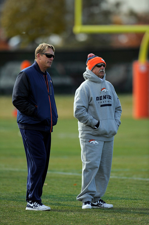 . Denver Broncos defensive coordinator Jack Del Rio talks with head trainer Steve Antonopulos during practice November 4, 2013 at Dove Valley. The Denver Broncos on Monday named Defensive Coordinator Jack Del Rio as the team�s interim head coach, Executive Vice President of Football Operations John Elway announced.  (Photo by John Leyba/The Denver Post)