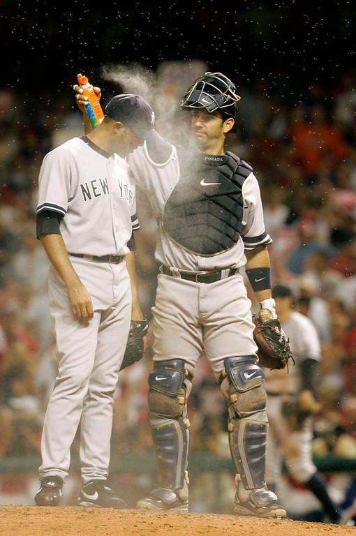 . New York Yankees catcher Jorge Posada, right, applies bug spray to relief pitcher Mariano Rivera before the bottom of the ninth inning in Game 2 of an American League Division Series baseball game against the Cleveland Indians in this Oct. 5, 2007, file photo in Cleveland. (AP Photo/Amy Sancetta, file)