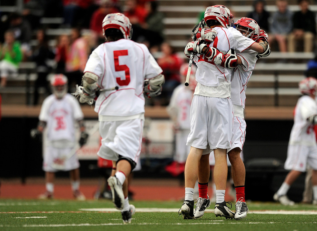 . DENVER, CO - MAY 15: Regis Jesuit players celebrate after scoring a goal against Arapahoe during a CHSAA 5A boys lacrosse semifinal game on May 15, 2013, in Denver, Colorado. Arapahoe won 13-5 to advance to the finals. (Photo by Daniel Petty/The Denver Post)