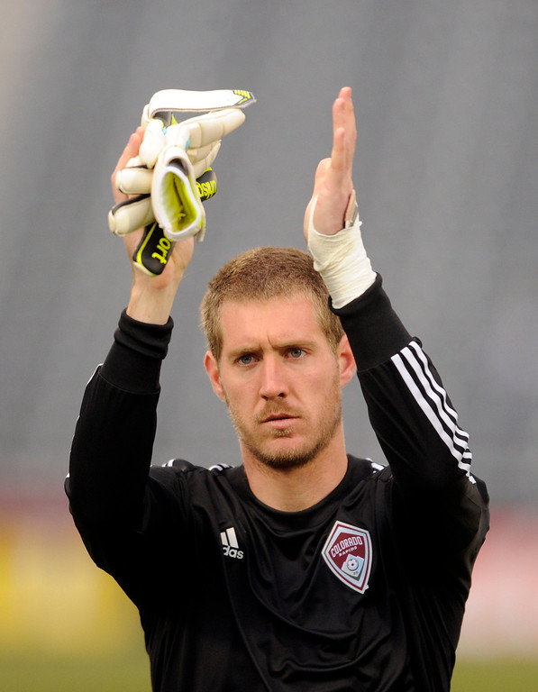 . Clint Irwin (31) of the Colorado Rapids applauded fans following the game. The Colorado Rapids tied the Portland Timbers 2-2 Saturday, March 30, 2013 at Dick\'s Sporting Goods Park in Commerce City.  Photo By Karl Gehring/The Denver Post)