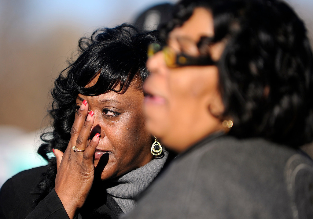 . Before the start of  Martin Luther King Jr. Marade in City Park,  Gail Booker, of Kansas City, Missouri, left, wipes away a tear after talking about her brother-in-law, Marvin Booker, who died while in police custody in Denver. The Booker family gathered at the MLK statue in the park as they continue to search for answers about Marvin Booker\'s death at the Denver Jail. The march/parade  was held on Monday, January 21, 2013.   (Photo By Cyrus McCrimmon / The Denver Post)