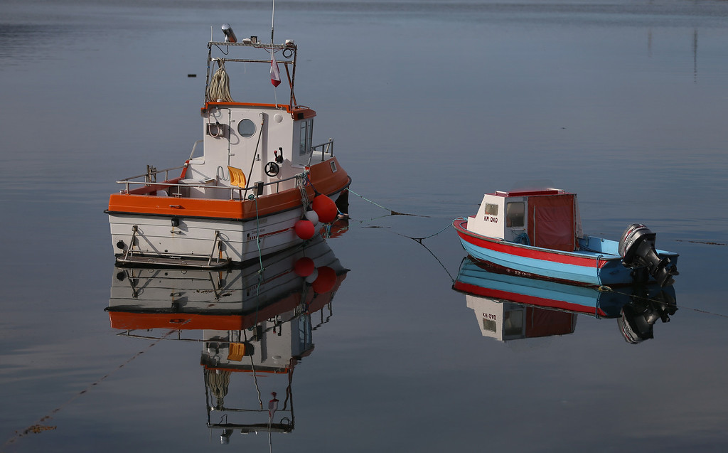 . Boats are seen at the port on July 31, 2013 in Qaqortoq, Greenland.  (Photo by Joe Raedle/Getty Images)