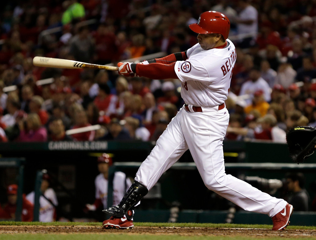 . St. Louis Cardinals\' Carlos Beltran hits a solo home run during the third inning of a baseball game against the Colorado Rockies, Friday, May 10, 2013, in St. Louis. (AP Photo/Jeff Roberson)