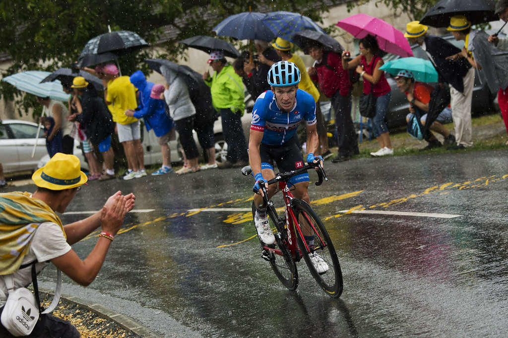 . Netherlands\' Tom Jelte Slagter rides in a breakaway under a heavy rain during the 208.5 km nineteenth stage of the 101st edition of the Tour de France cycling race on July 25, 2014 between Maubourguet Pays du Val d\'Adour and Bergerac, southwestern France.  AFP PHOTO / JEFF PACHOUD/AFP/Getty Images