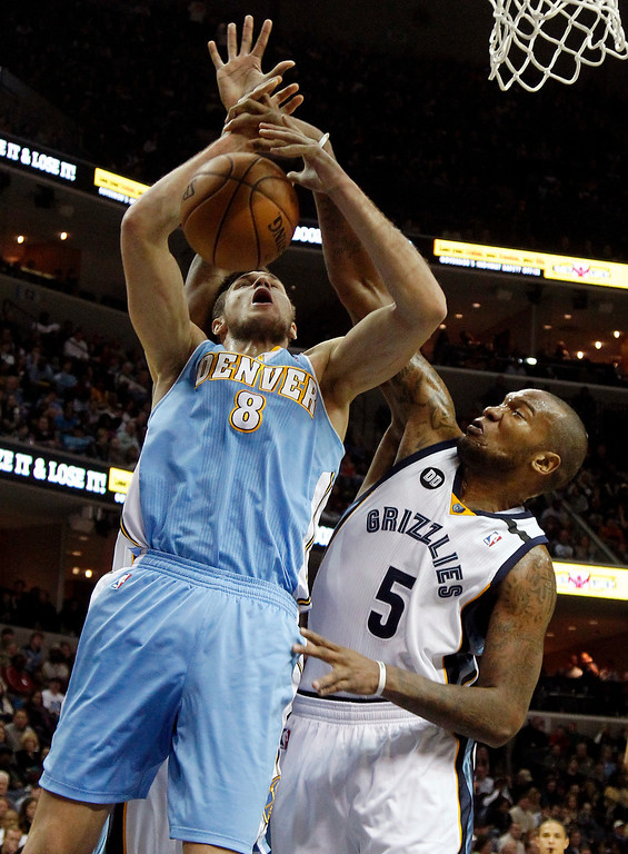 . Memphis Grizzlies forward Marreese Speights (5) knocks the ball away from Denver Nuggets forward Danilo Gallinari (8), of Italy, in the first half of an NBA basketball game on Saturday, Dec. 29, 2012, in Memphis, Tenn. (AP Photo/Lance Murphey)