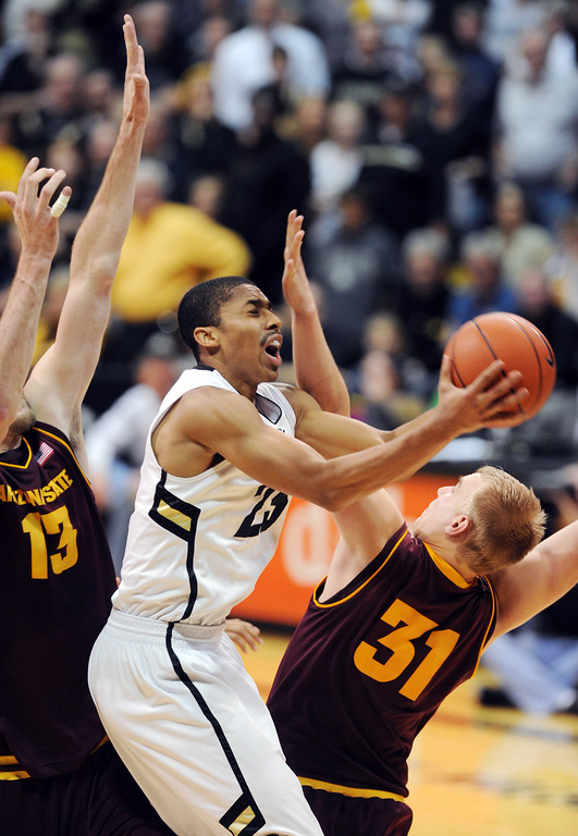 . Spencer Dinwiddie of CU drives into Jonathan Gilling of ASU during the second half of the February 16th, 2013 game in Boulder. Cliff Grassmick / February 16, 2013
