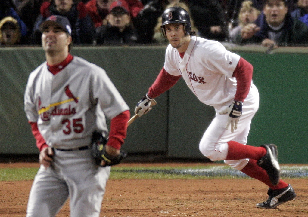 . Boston Red Sox\' Mark Bellhorn, right, and St. Louis Cardinals pitcher Matt Morris watch Bellhorn\'s two-run double in the fourth inning of game two of the World Series in Boston, Sunday Oct. 24, 2004. (AP Photo/Amy Sancetta)