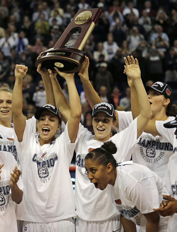 . Connecticut celebrates after beating Kentucky in the women\'s NCAA East  regional final basketball game against in Bridgeport, Conn., Monday, April 1, 2013. Connecticut won 83-53 and advances to the Final Four. (AP Photo/Charles Krupa)