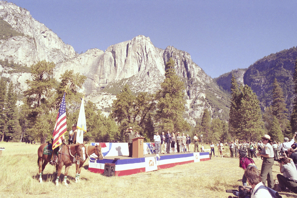 . As mounted rangers present colors Park Superintendent Michael Finley and other dignitaries kick off Yosemite National Park\'s Centennial observe in Sentinel Meadow on Monday, Oct. 1, 1990. In the background is Yosemite Point. More than 1,000 attended the meadow ceremonies. (AP Photo/Sal Veder)