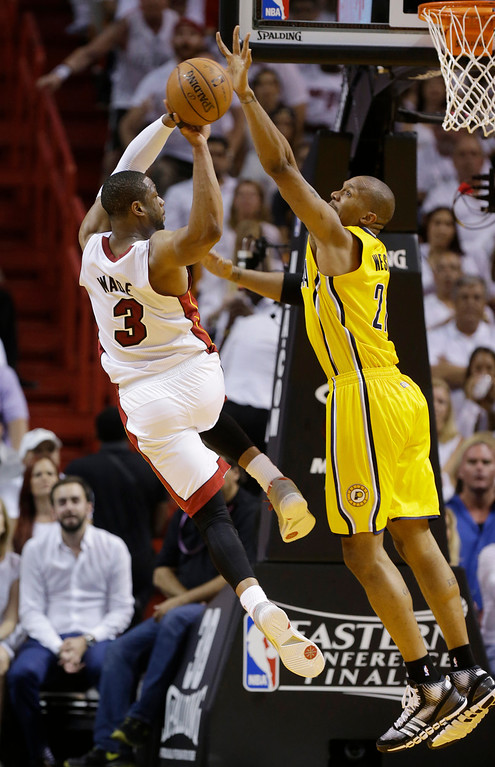 . Indiana Pacers forward David West (21) attempts to block a drive to the basket by Miami Heat guard Dwyane Wade (3) during the first half Game 6 in the NBA basketball playoffs Eastern Conference finals on Friday, May 30, 2014, in Miami. (AP Photo/Lynne Sladky)