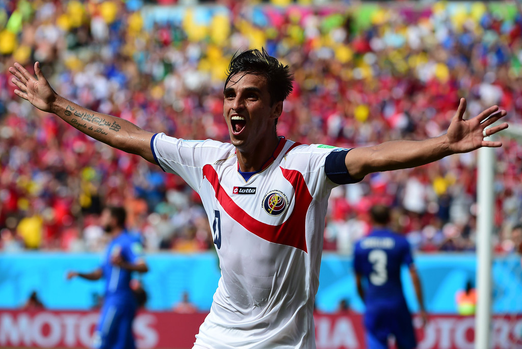 . Costa Rica\'s forward Bryan Ruiz celebrates after scoring his team\'s first goal during a Group D match between Italy and Costa Rica at the Pernambuco Arena in Recife during the 2014 FIFA World Cup on June 20, 2014. RONALDO SCHEMIDT/AFP/Getty Images