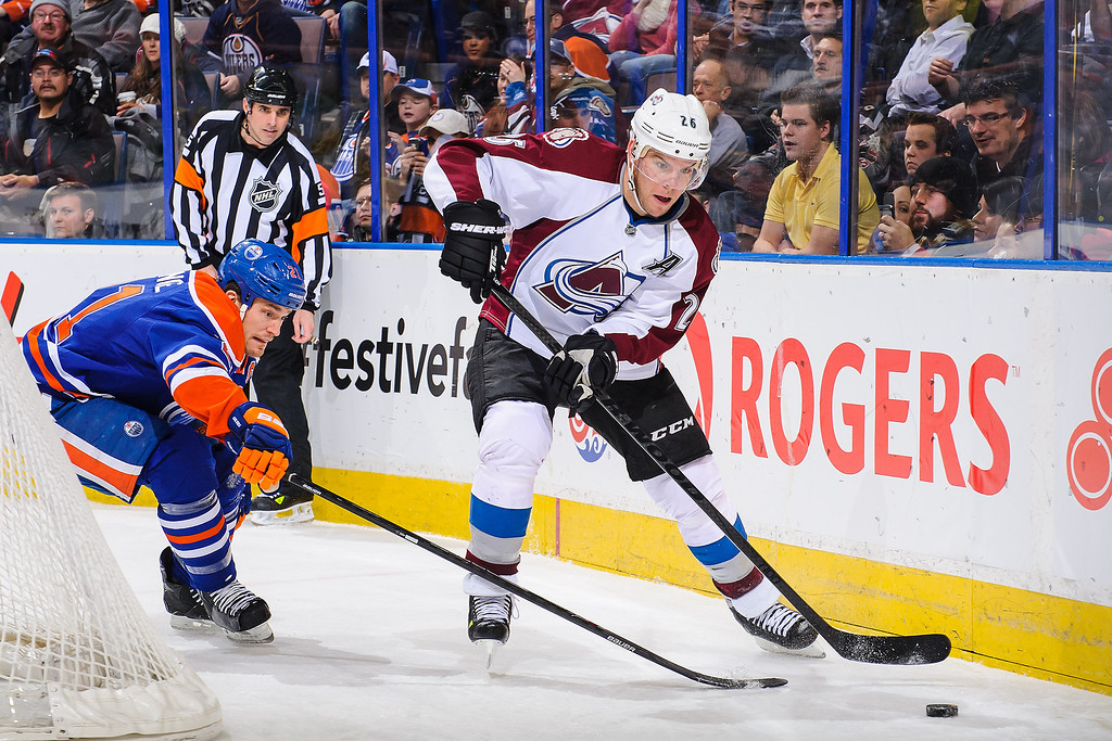 . EDMONTON, AB - DECEMBER 5: Andrew Ference #21 of the Edmonton Oilers tries to check Paul Stastny #26 of the Colorado Avalanche during an NHL game at Rexall Place on December 5, 2013 in Edmonton, Alberta, Canada. The Oilers defeated the Avalanche 8-2. (Photo by Derek Leung/Getty Images)