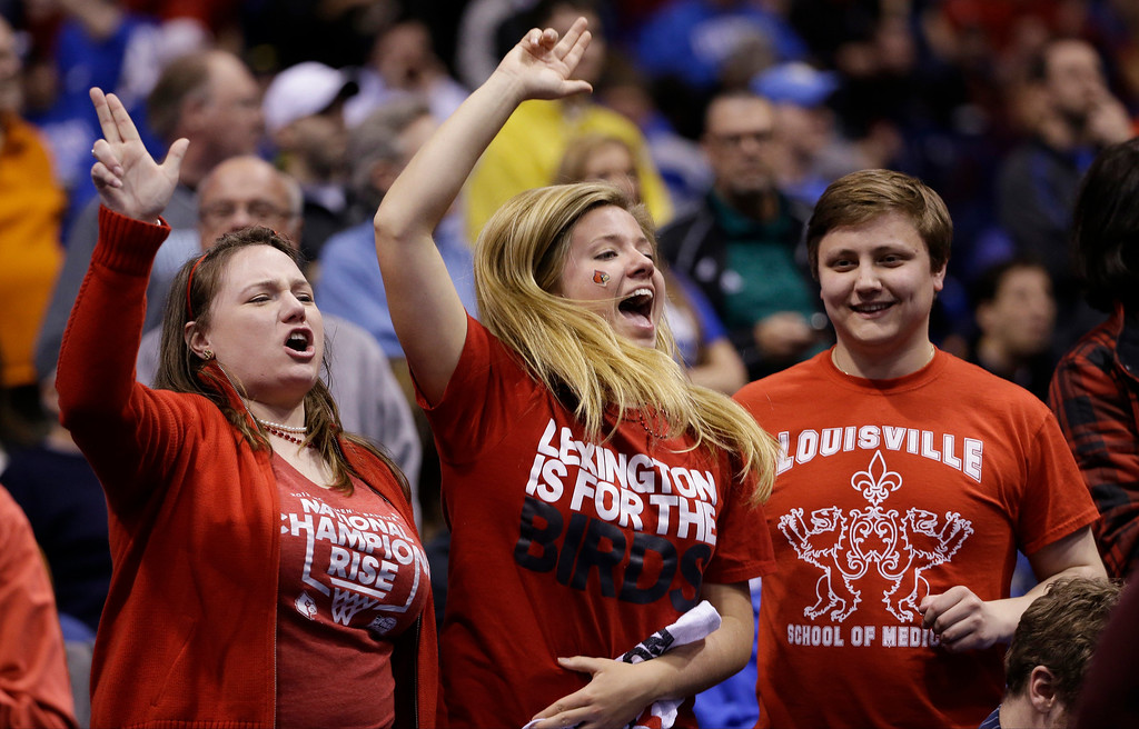 . Louisville fans cheer before an NCAA Midwest Regional semifinal college basketball tournament game against the Kentucky Friday, March 28, 2014, in Indianapolis. (AP Photo/David J. Phillip)
