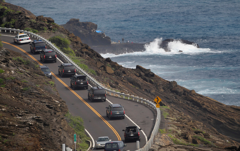 . A motorcade carrying President Barack Obama drives the Kalanianaole Highway on the east coast of Oahu, Hawaii, while on vacation with the first family, Tuesday, Dec. 28, 2010. (AP Photo/Carolyn Kaster)