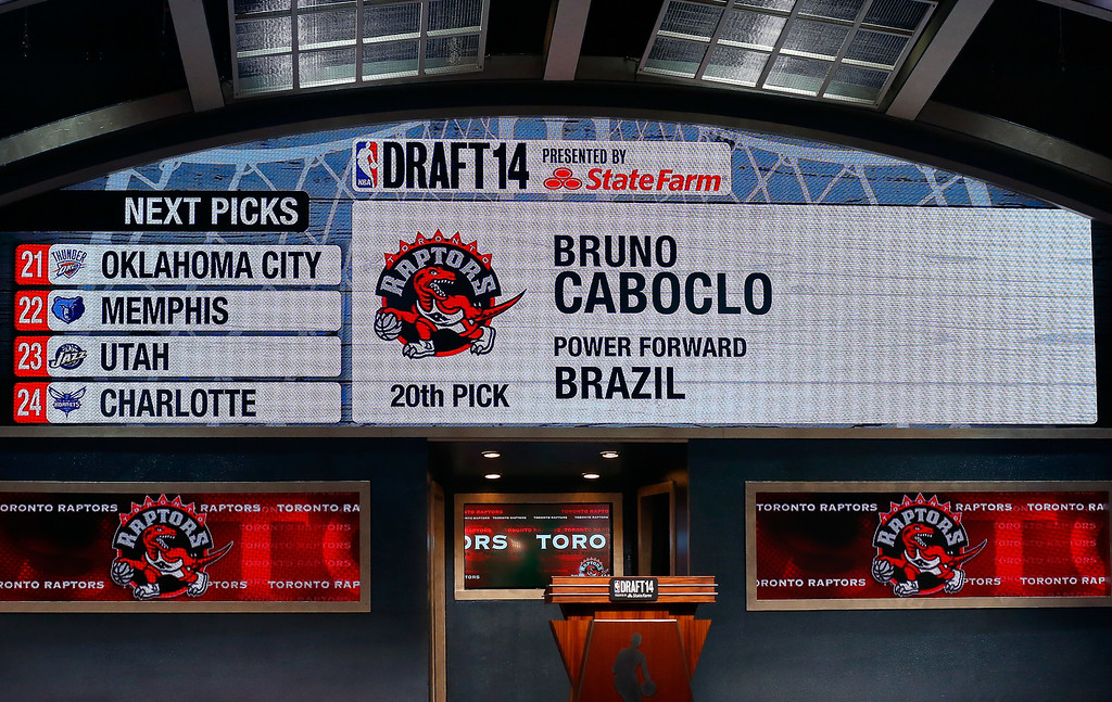 . A video screen shows the selection of Bruno Caboclo of Brazil as the #20 overall pick in the first round by the Toronto Rapters during the 2014 NBA Draft at Barclays Center on June 26, 2014 in the Brooklyn borough of New York City.   (Photo by Mike Stobe/Getty Images)
