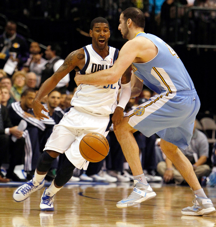 . The Dallas Mavericks\' O.J. Mayo draws a foul on the Denver Nuggets\' Kosta Koufos, right, at the American Airlines Center in Dallas, Texas, on Friday, December 28, 2012. (Richard W. Rodriguez/Fort Worth Star-Telegram/MCT)