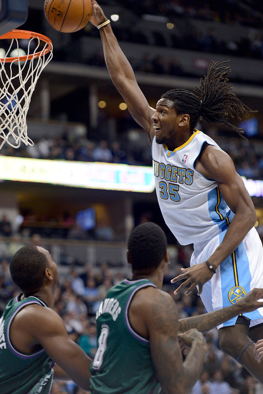 . DENVER, CO. - FEBRUARY 05: Kenneth Faried (35) of the Denver Nuggets goes up for a dunk on Luc Richard Mbah a Moute (12) of the Milwaukee Bucks and Larry Sanders (8) of the Milwaukee Bucks during the second quarter February 05, 2013 at Pepsi Center. The Denver Nuggets take on the Milwaukee Bucks in NBA action. (Photo By John Leyba/The Denver Post)