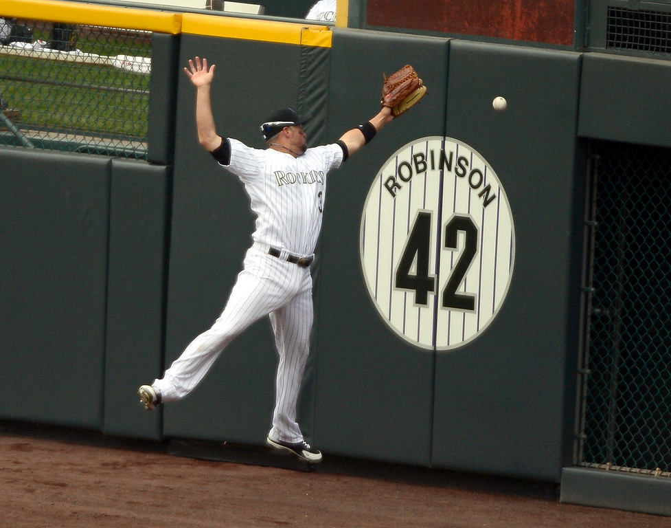 . DENVER, CO. - APRIL 21: Martin Prado of the Arizona Diamondbacks singles on a line drive to right fielder Michael Cuddyer (3) of the Colorado Rockies as it sails over his head and hit the wall in the ninth inning April 21, 2013 at Coors Field. (Photo By John Leyba/The Denver Post)