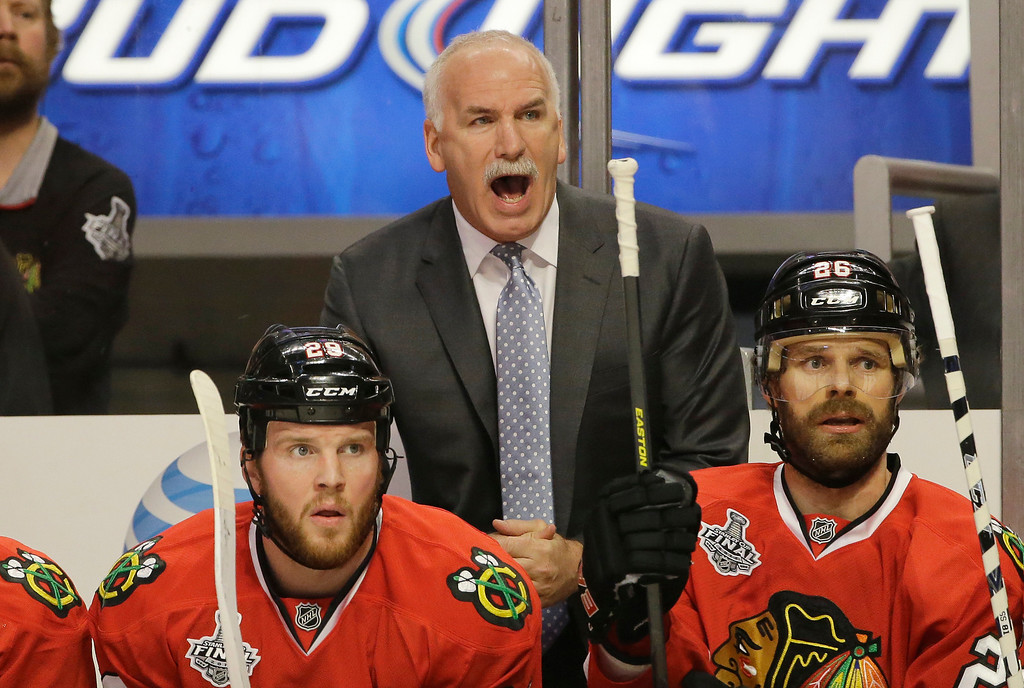 . Chicago Blackhawks head coach Joel Quenneville directs his team during the first period of Game 1 in their NHL Stanley Cup Final hockey series against the Boston Bruins, Wednesday, June 12, 2013, in Chicago. (AP Photo/Nam Y. Huh)