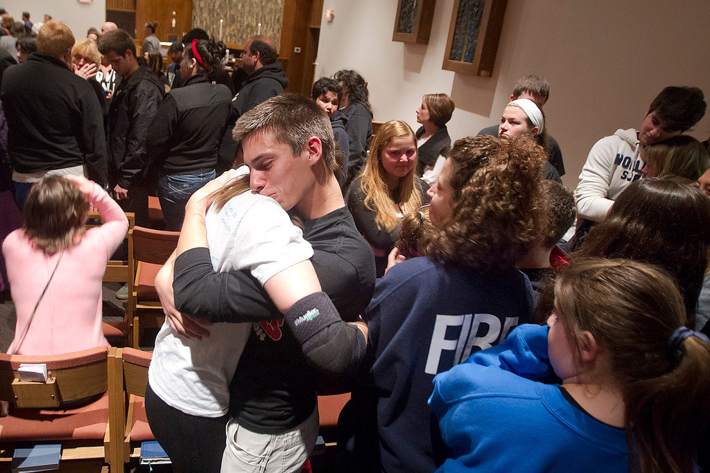 . Marshall McCarl, 16, mourned the loss of Reat Underwood, a classmate at Blue Valley High School who was shot and killed Sunday outside of the Jewish Community Center. People gathered to mourn the victims of the shooting at the Jewish Community Center and Village Shalom during a vigil  Sunday night at St. Thomas The Apostle Episcopal Church in Overland Park. (TAMMY LJUNGBLAD/The Kansas City Star)