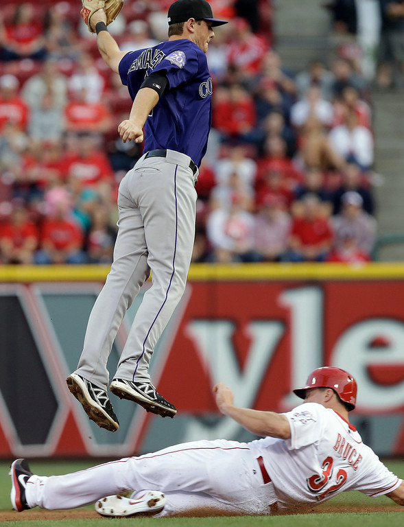. Cincinnati Reds\' Jay Bruce (32) steals second base as Colorado Rockies second baseman DJ LeMahieu is pulled off the bag by a high throw in the fourth inning of a baseball game, Monday, June 3, 2013, in Cincinnati. (AP Photo/Al Behrman)