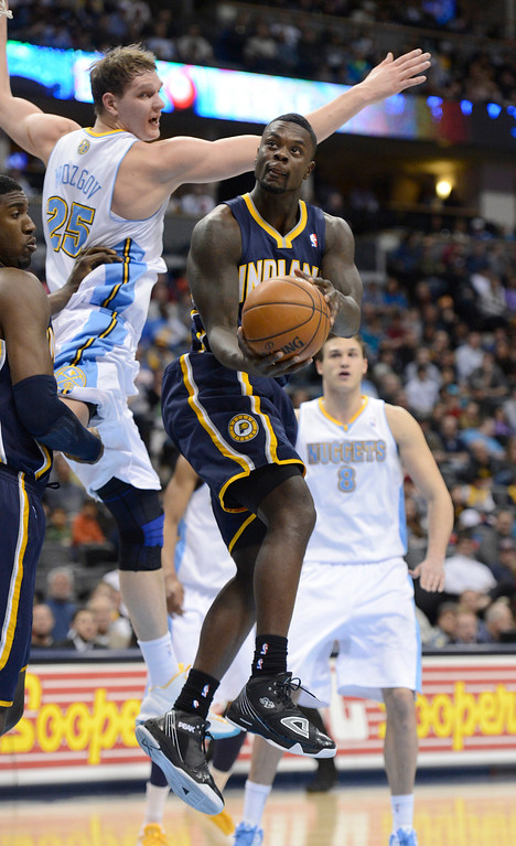 . DENVER, CO. - JANUARY 28: Indiana Pacers shooting guard Lance Stephenson (1) goes up for a reverse layup past Denver Nuggets center Timofey Mozgov (25) during the second quarter January 28, 2013 at Pepsi Center. The Denver Nuggets host the Indiana Pacers in NBA action.  (Photo By John Leyba / The Denver Post)