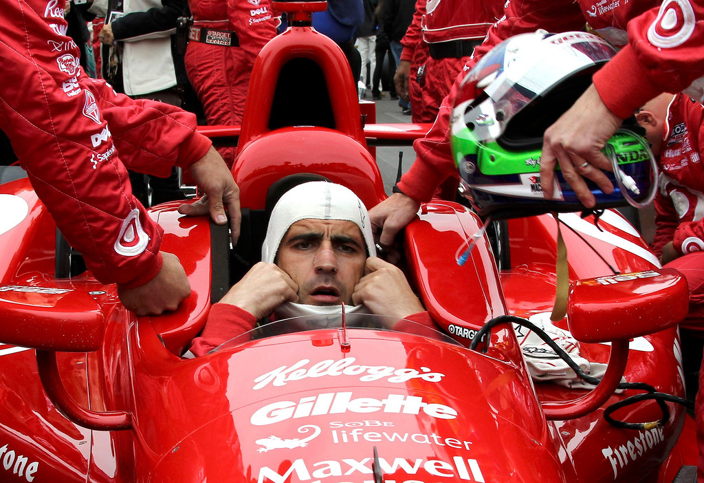 . Target Chip Ganassi Racing driver Dario Franchitti of Britain dons his headgear ahead of the 97th running of the Indianapolis 500 at the Indianapolis Motor Speedway in Indianapolis, Indiana, May 26, 2013. REUTERS/Kirk Debrunner