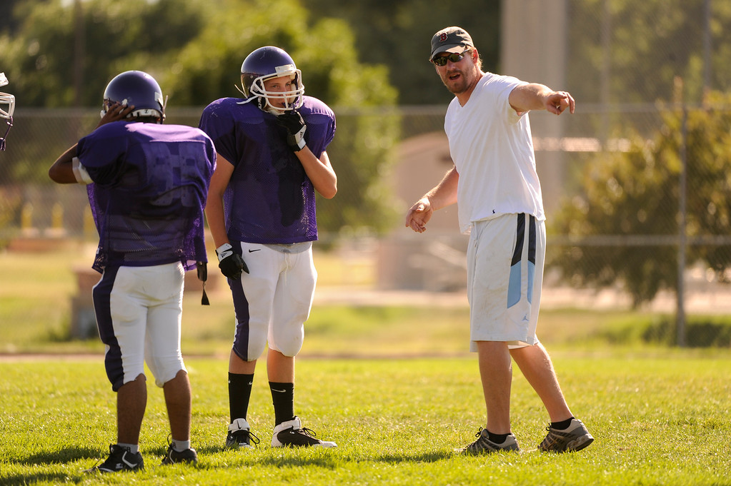 . Former Denver Broncos center Tom Nalen a volunteer line coach for the South High School Rebels football team.  Nalen coached practice Friday afternoon, August 20, 2009.   Karl Gehring/The Denver Post