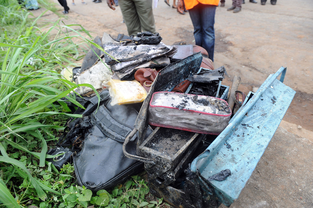 . This picture taken on October 3, 2013 shows the personal effects of passengers of an Associated Airlines plane that crash-landed at Sahara Airport shortly after takeoff in Lagos.  AFP PHOTO/ PIUS UTOMI EKPEI /AFP/Getty Images