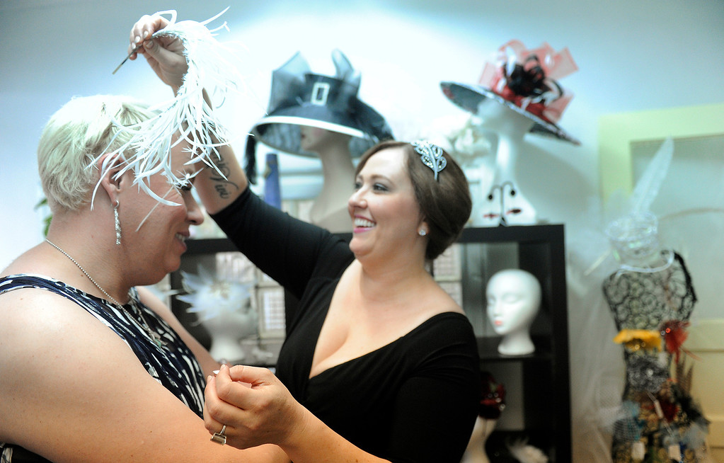 . With their wedding only weeks away, Koko, left and  Sara, right, visit the Kitty Mae Millinery to talk about hats  for their wedding on Monday, June 17, 2013  (Photo By Cyrus McCrimmon/The Denver Post)