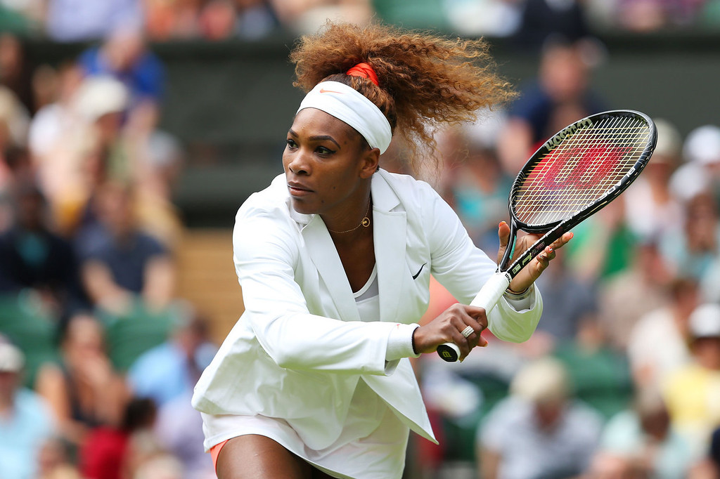 . Serena Williams of the United States of America plays a backhand during the warm-up before her Ladies\' Signles first round match against Mandy Minella of Luxembourg on day two of the Wimbledon Lawn Tennis Championships at the All England Lawn Tennis and Croquet Club on June 25, 2013 in London, England.  (Photo by Julian Finney/Getty Images)