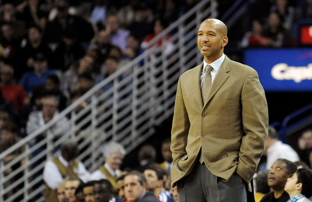 . New Orleans Pelicans head coach, Monty Williams watches the action in the second half of an NBA basketball game against the Denver Nuggets in New Orleans, Friday, Dec. 27, 2013.  New Orleans won 105-89. (AP Photo/Stacy Revere)