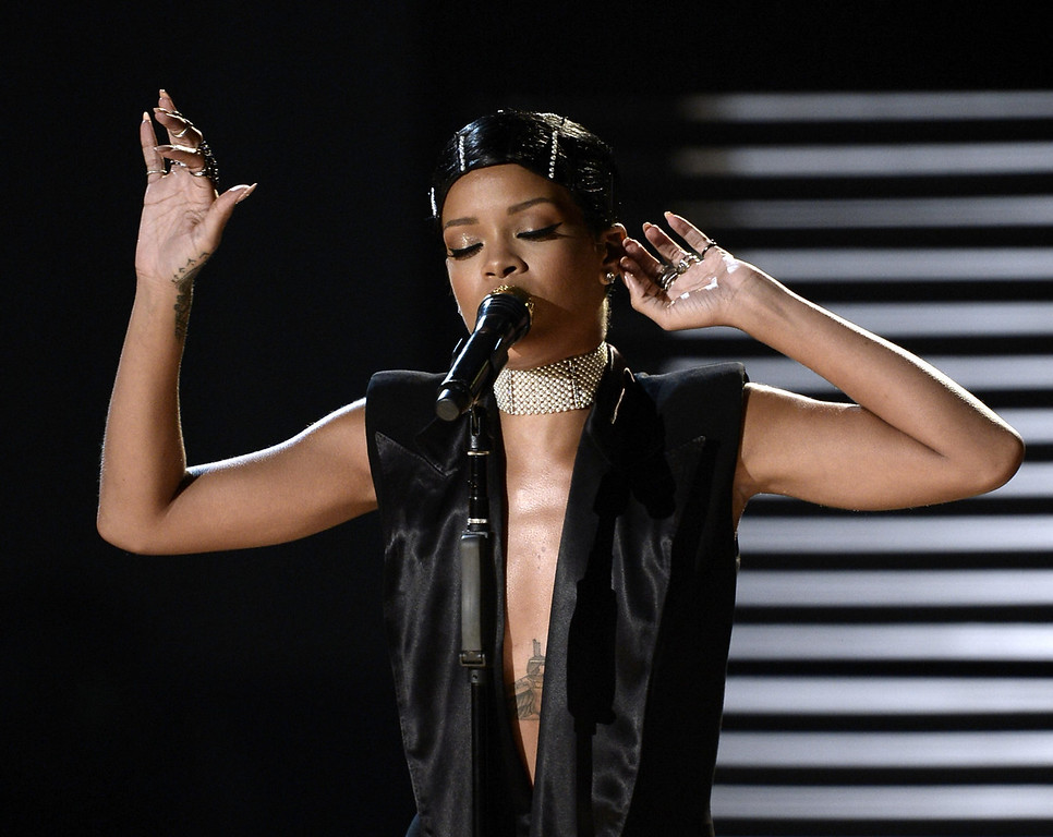 . Singer Rihanna performs onstage during the 2013 American Music Awards at Nokia Theatre L.A. Live on November 24, 2013 in Los Angeles, California.  (Photo by Kevin Winter/Getty Images)