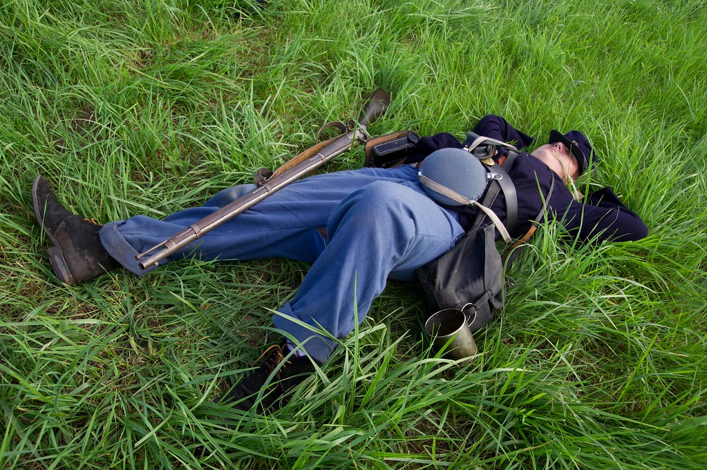 . A Union troop lies on the ground during a re-enactment of the Battle of Gettysburg on June 28, 2013 at the start of the 150th Gettysburg celebration and re-enactments in Gettysburg, Pennsylvania. Over three days, more than 10,000 re-enactors will pay tribute the major battles that took place in Gettysburg during the 1861-1865 US Civil War. KAREN BLEIER/AFP/Getty Images