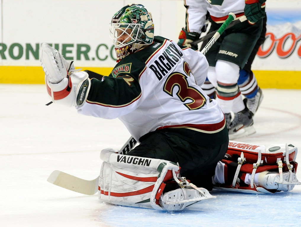 . Minnesota Wild goalie Niklas Backstrom (32) from Finland makes a glove save against the Colorado Avalanche during the third period of an NHL hockey game on Saturday, March 16, 2013, in Denver. Minnesota beat Colorado 6-4. (AP Photo/Jack Dempsey)