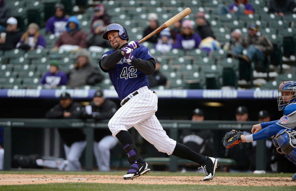 . Michael Cuddyer of the Colorado Rockies hits a double against the New York Mets during the second inning April 16, 2013 at Coors Field. Both teams wore the number 42 in honor of Jackie Robinson. (Photo By John Leyba/The Denver Post)
